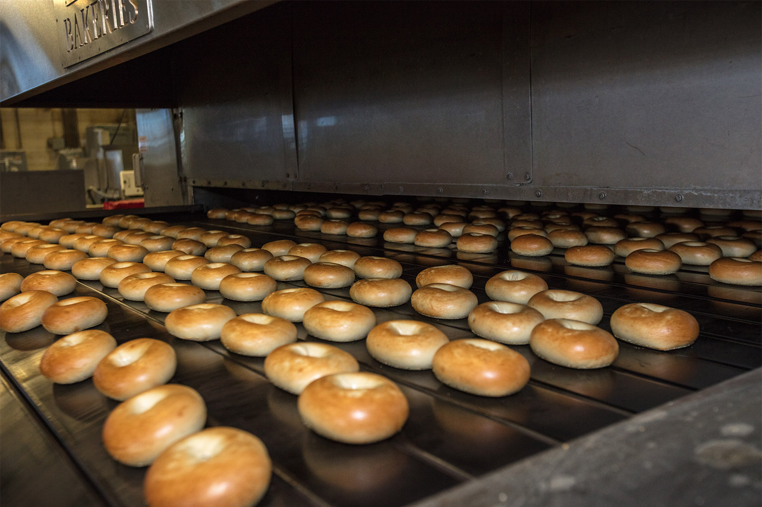 Bagels coming out of an oven