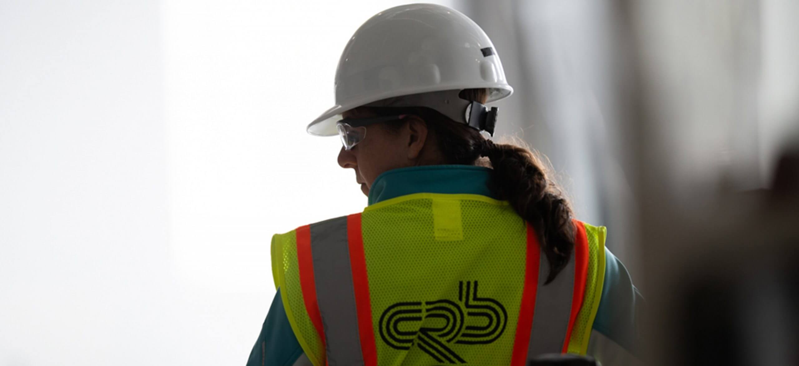 Female CRB construction employee in personal protection equipment