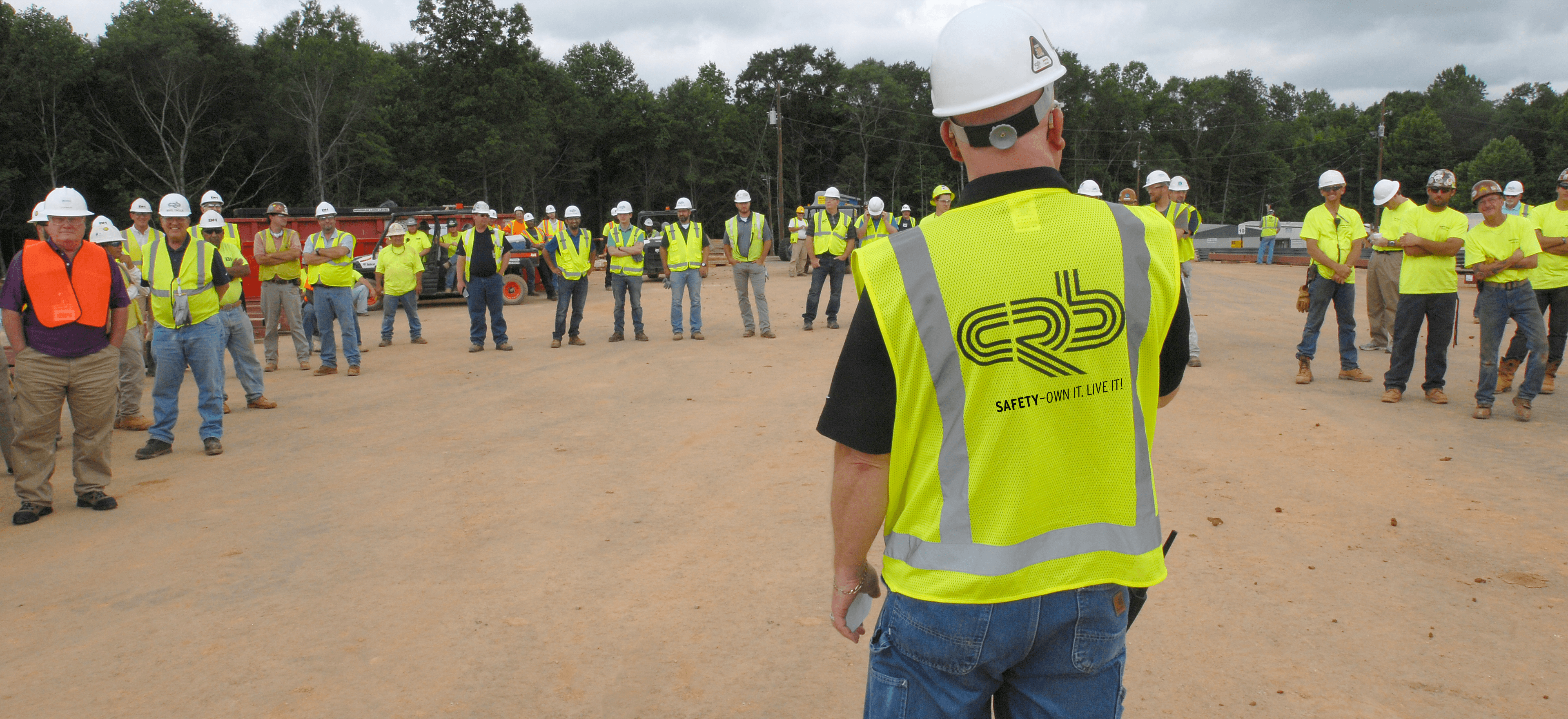 Construction safety leader on site talks to CRB team