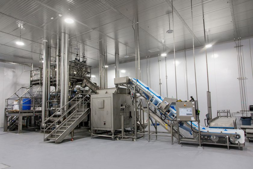 Meat processing equipment in pet treat manufacturing facility